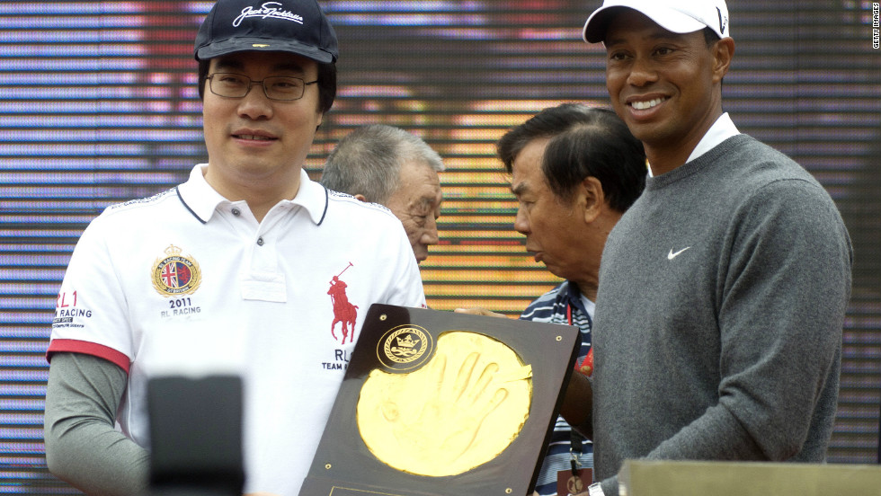 Both McIlroy and Woods, pictured above, had their handprints immortalized in clay as a lavish ceremony featuring drum majorettes and fireworks preceded their clash in the Chinese city Zhengzhou.