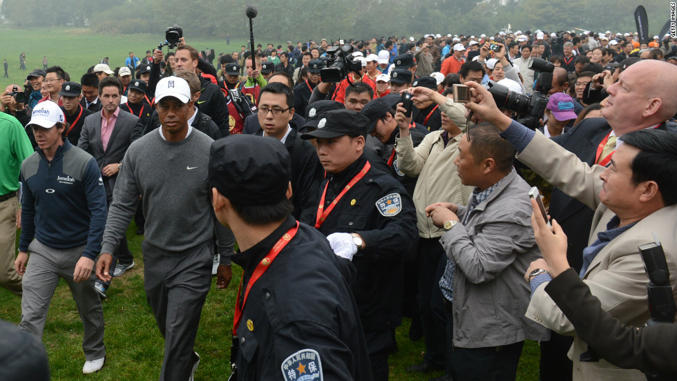 """The scene was barely-controlled chaos,"" <a href=""http://blogs.golf.com/presstent/2012/10/tiger-woods-rory-mcilroy-set-for-duel-in-china.html"" target=""_blank"">wrote Sports Illustrated's Alan Shipnuck</a>. ""Some 3,000 fans streamed across the fairways, with soldiers locking arms in a human fence to keep the throngs off the greens."""