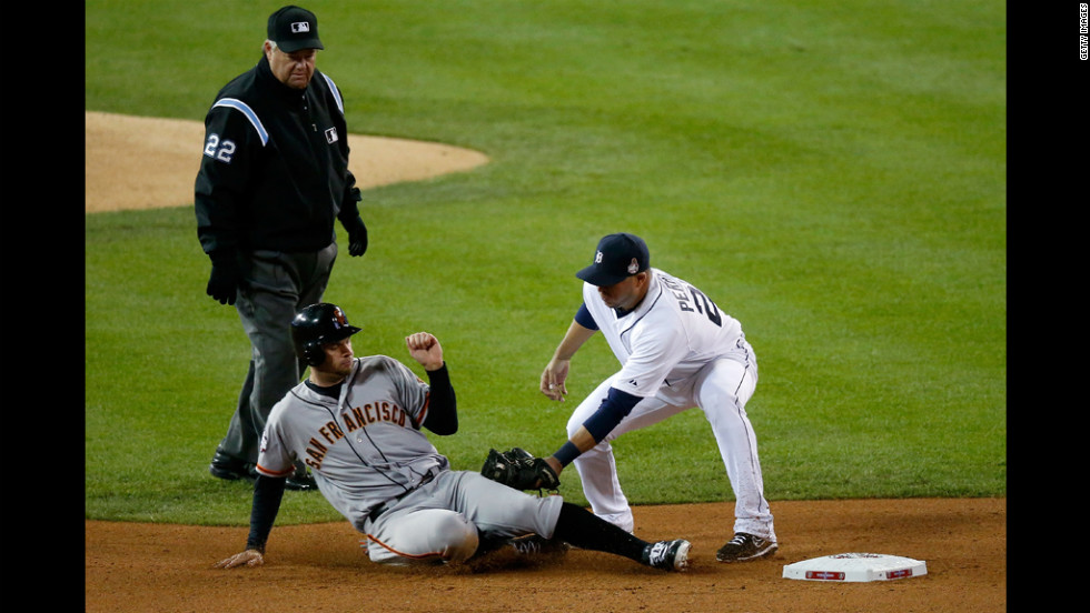 Brandon Belt of the Giants gets tagged out stealing second base by Jhonny Peralta of the Tigers in the fourth inning.