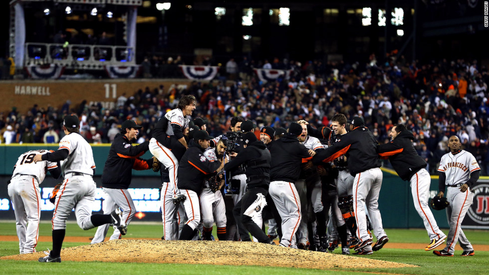 "The San Francisco Giants celebrate after the team beat the Detroit Tigers in 10 innings to win the World Series on Sunday, October 28, at Comerica Park in Detroit. The Giants defeated the Tigers 4-3 to sweep the series in four games. <a href=""http://www.cnn.com/2012/10/27/worldsport/gallery/world-series-game-3/index.html"">See the best photos of Game 3 here</a>."