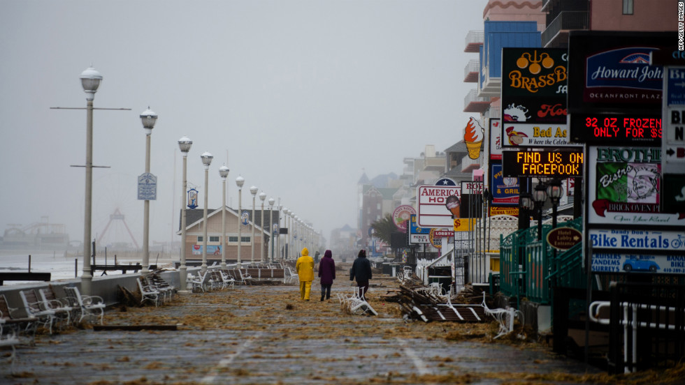 People walk on the boardwalk in Ocean City, Maryland, on Monday.