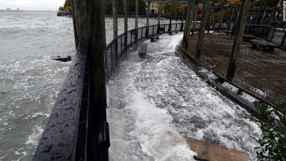 The Hudson River comes over the sea wall along the West Side Promenade in the Battery Park area in New York on Monday.