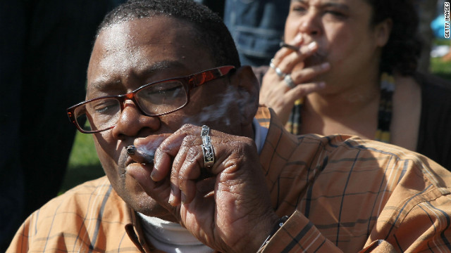 A  man joins other pro-marijuana activists in smoking pot at a rally in San Francisco to legalize the drug.