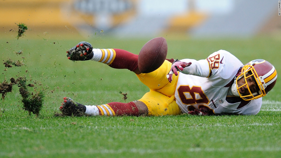 Santana Moss of the Washington Redskins loses control of a pass during the fourth quarter against the Pittsburgh Steelers on Sunday, October 28, in Pittsburgh.