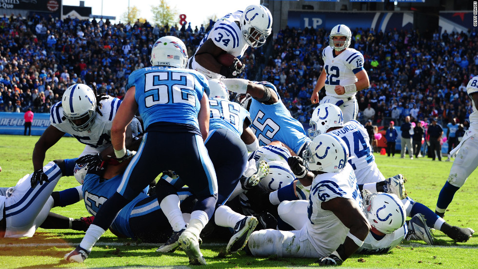 Colts No. 34 Delone Carter dives over a pileup for a touchdown on Sunday.