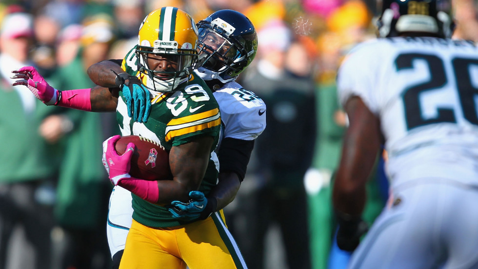 Jacksonville's Mike Harris tackles Green Bay's James Jones on Sunday.