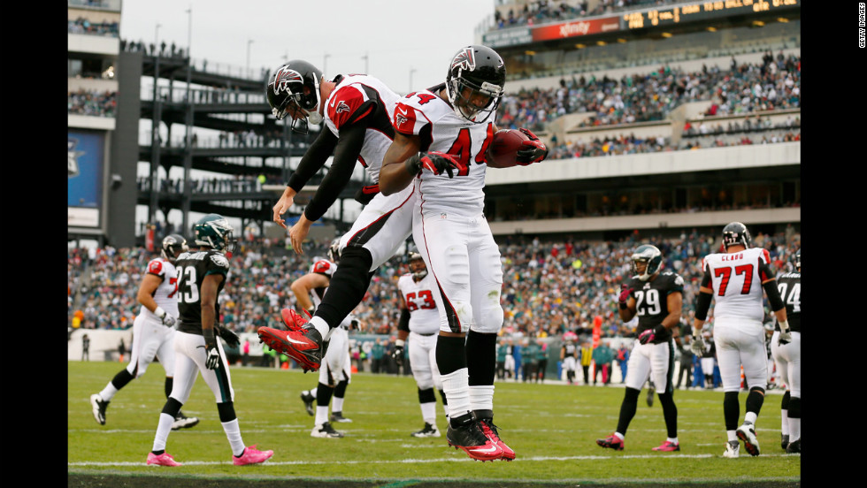 Falcons No. 44, fullback Jason Snelling, and No. 2, quarterback Matt Ryan, celebrate on Sunday after a first quarter touchdown.