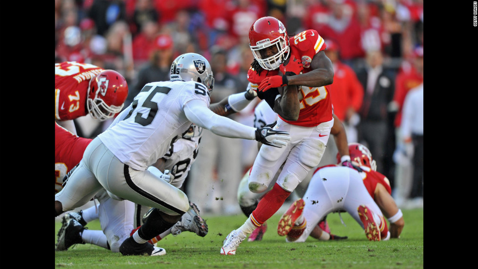Chiefs running back Jamaal Charles rushes around Raiders linebacker Rolando McClain during the third quarter.