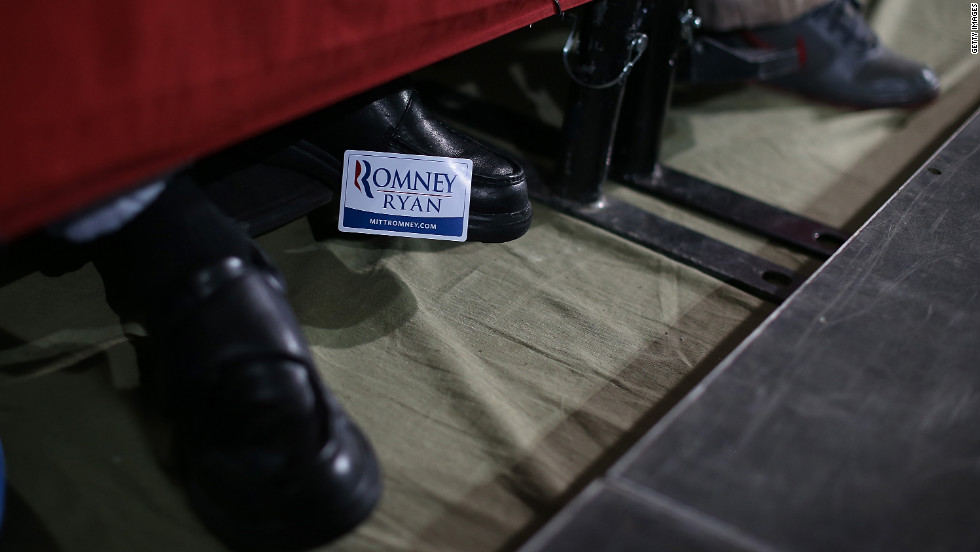 A supporter of Mitt Romney and Paul Ryan wears a campaign sticker on his shoe during a campaign rally at the Celina Fieldhouse in Celina, Ohio, on Sunday, October 28.