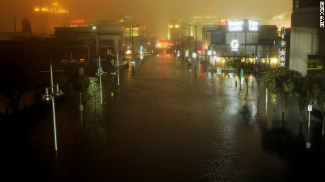 ATLANTIC CITY, NJ - OCTOBER 29:  A flooded street is seen at nightfall during rains from Hurricane Sandy on October 29, 2012 in Atlantic City, New Jersey. Sandy made landfall over Southern New Jersey today.  (Photo by Mario Tama/Getty Images)