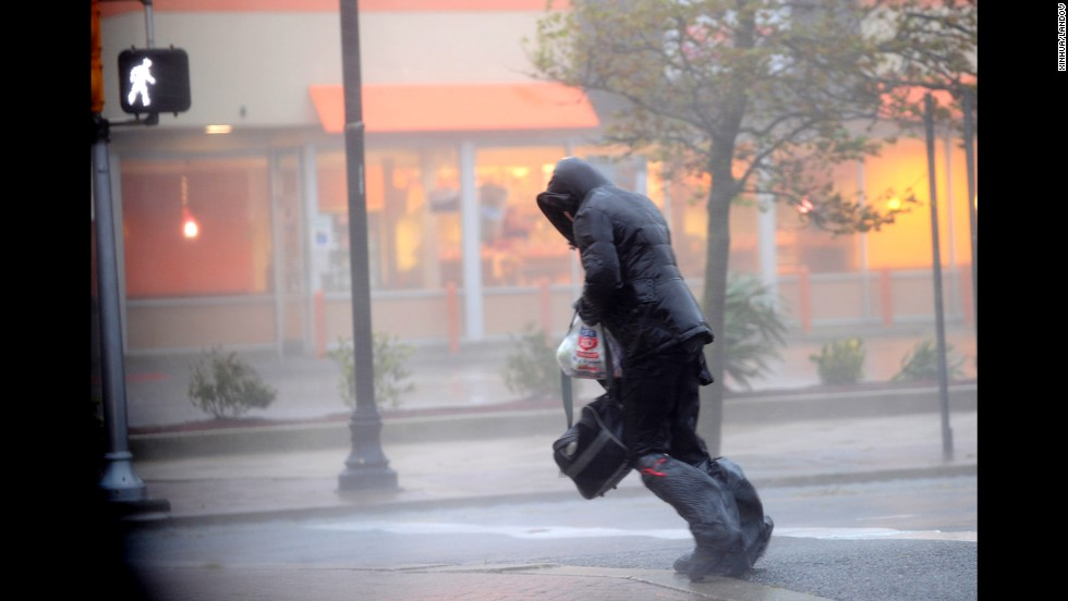 A person tries to cross the street during the storm on Monday in Atlantic City.