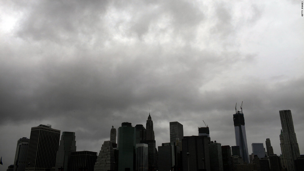 The Manhattan skyline remains dark after much of the city lost electricity in the storm.