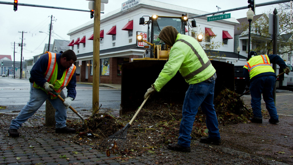 Workers shovel debris from the streets in Ocean City, Maryland, on Tuesday.