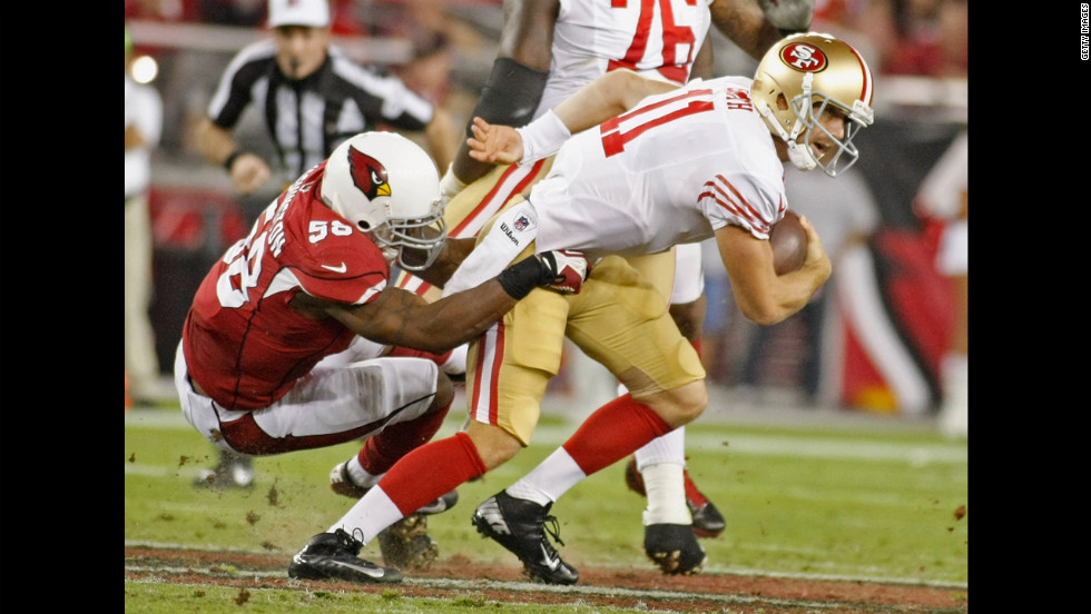 San Francisco 49ers quarterback Alex Smith is sacked by Daryl Washington of the Arizona Cardinals.