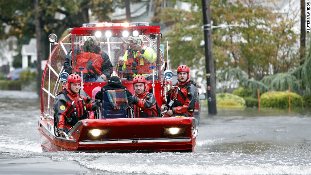 Rescue workers use a hovercraft to rescue a wheelchair-bound resident from flood waters in Little Ferry, New Jersey, on Tuesday.
