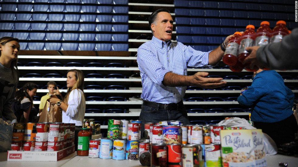 Mitt Romney helps gather donated goods for storm relief Tuesday in Kettering, Ohio.