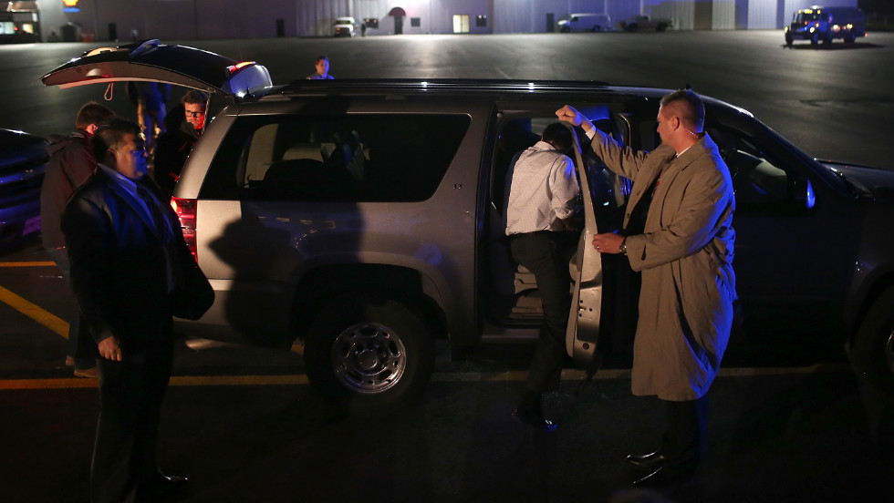Romney gets into his SUV after landing Monday in Vandalia, Ohio.