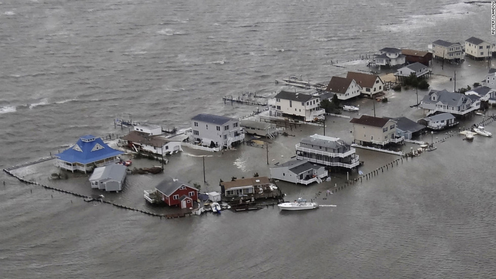 Homes are flooded Tuesday in Tuckerton, New Jersey. President Barack Obama signed major disaster declarations for New Jersey and New York, clearing the way for federal aid.