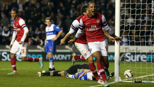 Theo Walcott celebrates his third goal and Arsenal's sixth as the Gunners complete a remarkable comeback at Reading.