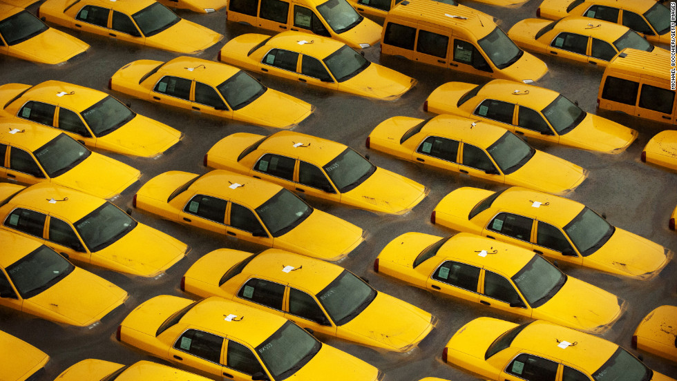 Taxis sit in a flooded lot Tuesday in Hoboken, New Jersey.