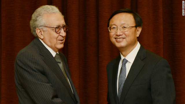 Lakhdar Brahimi, left, shakes hands with Yang Jiechi before their meeting in Beijing on Wednesday.