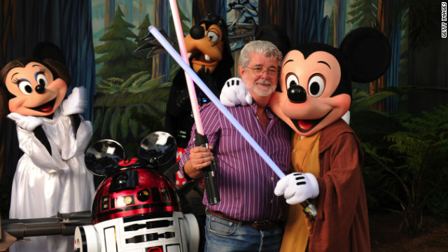 George Lucas meets characters at Disney's Hollywood Studios theme park in Lake Buena Vista, Florida, in August 2010.