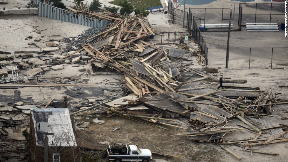 Debris from damaged property and the remains of a boardwalk litter the shoreline in Atlantic City on Wednesday.