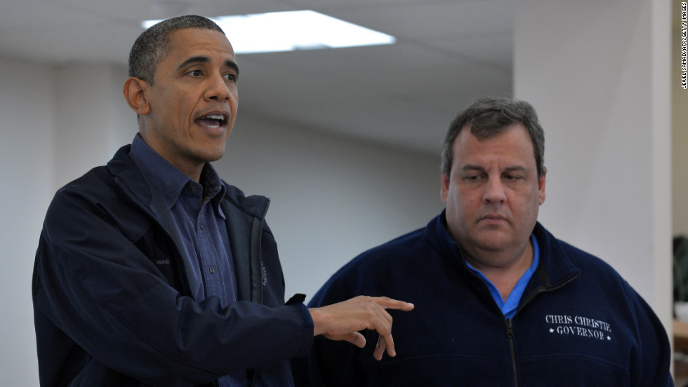 President Barack Obama speaks as New Jersey Gov. Chris Christie looks on, as they visit a shelter for Hurricane Sandy victims in Brigantine, New Jersey.