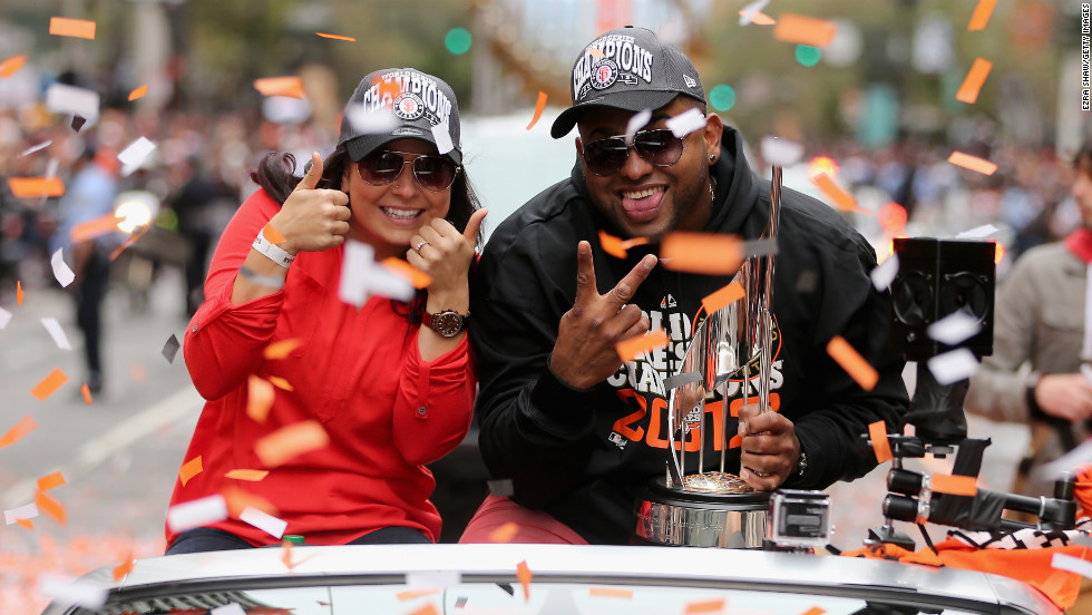 "Pablo Sandoval, nicknamed ""Kung Fu Panda,"" holds his World Series MVP trophy."