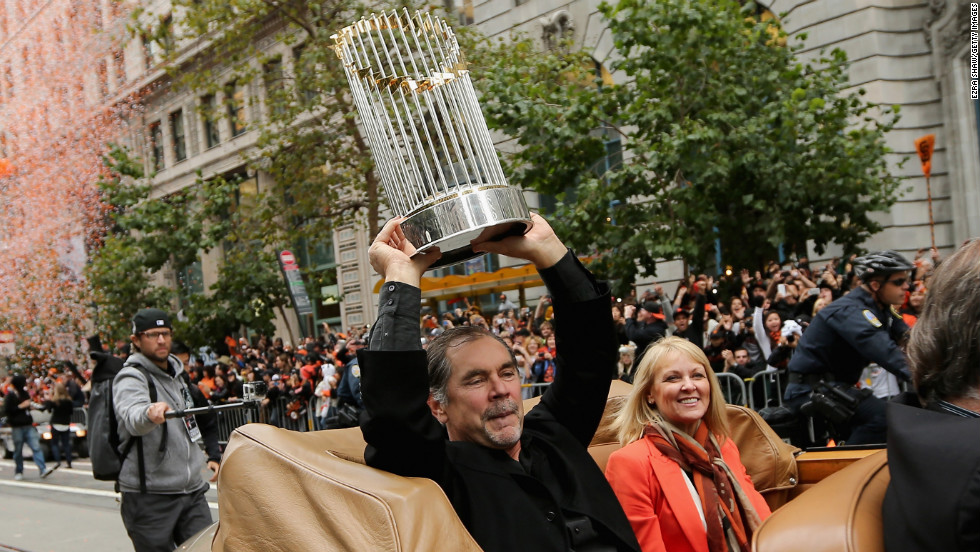 Giants manager Bruce Bochy holds up the World Series trophy.