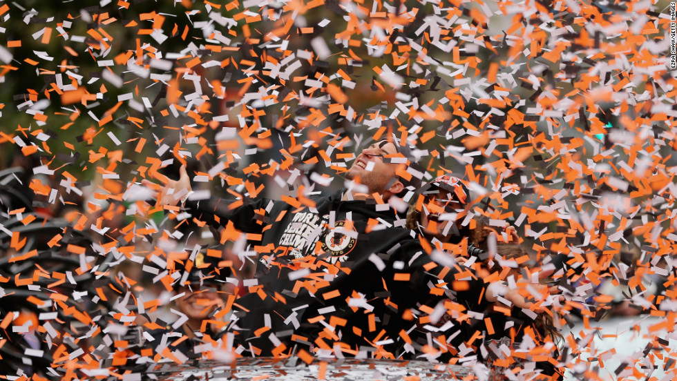 Marco Scutaro is covered in confetti during Wednesday's victory parade.