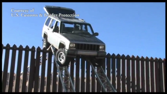 Jeep gets stuck on top of border fence