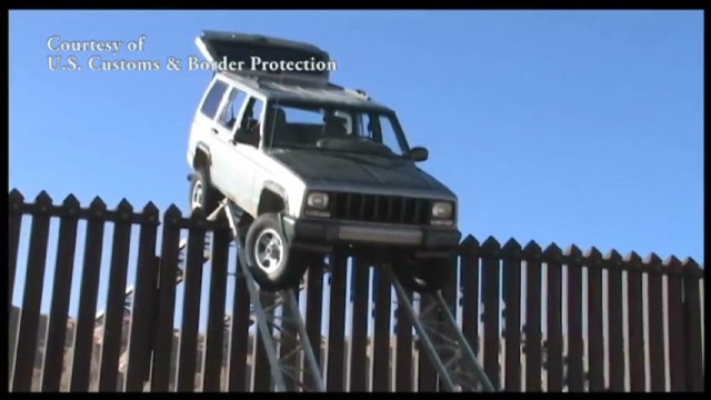 smugglers jeep stuck on border fence_00004511