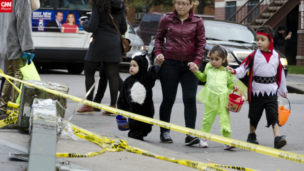 "<a href=""http://ireport.cnn.com/docs/DOC-869953"">Luis C. Muniz </a>photographed people in the New York borough of Brooklyn celebrating Halloween. ""Even though most of New York City is still paralyzed and without electricity, the spirit of Halloween is alive and well,"" he said."