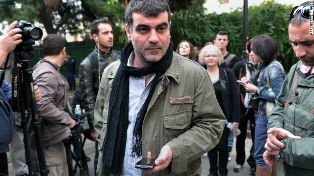 Kostas Vaxevanis, a veteran investigative journalist, awaits the beginning of his trial at a court in Athens on Novemeber 1, 2012.