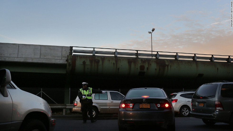 A police officer directs traffic entering the Brooklyn Queens Expressway into Manhattan.