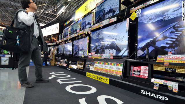 A customer checks LCD television sets made by Japanese electronics maker Sharp on November 1.