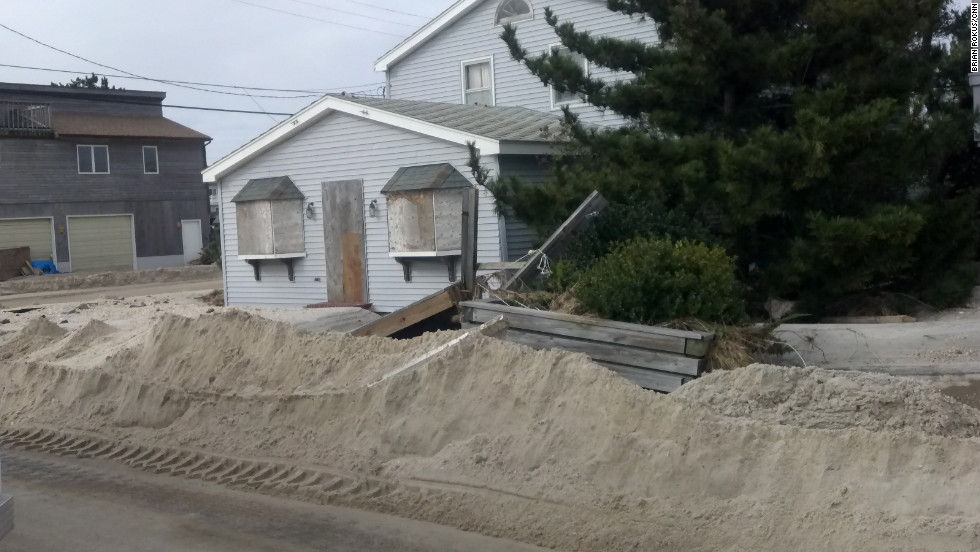 Yards are buried in about 4 feet of sand in Holgate on Long Beach Island.