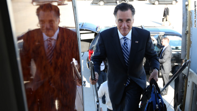 Republican presidential candidate Mitt Romney boards his campaign plane on November 2 in Milwaukee.