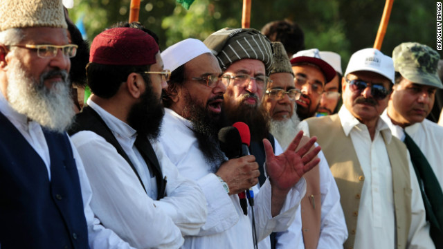 Pakistani Islamic religious leaders from the Defence of Pakistan coalition look on as Hafiz Mohammad Saeed (3L), addresses an anti-US rally against a US-made anti-Islam film and the publication of blasphemous cartoons in France, in Peshawar on October 1, 2012.