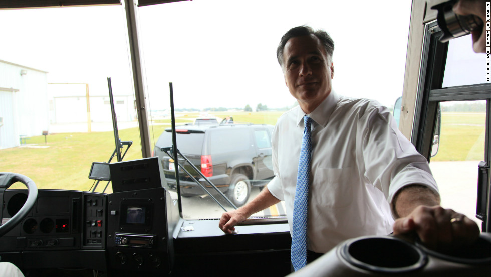 Romney stands at the front of his campaign bus in Kissimmee, Florida, on Oct. 27, 2012.