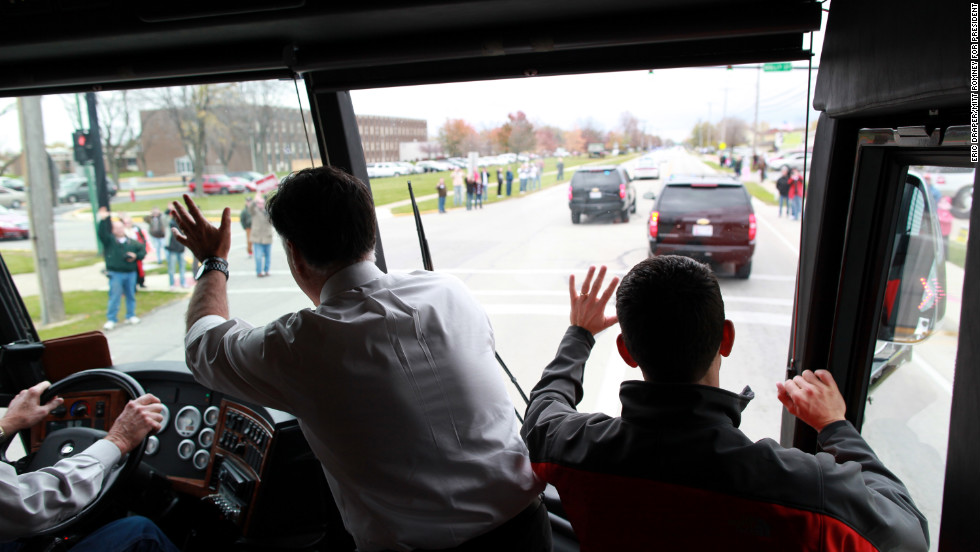 Romney and Rep. Paul Ryan wave aboard their campaign bus in Celina, Ohio, on Oct. 28, 2012.