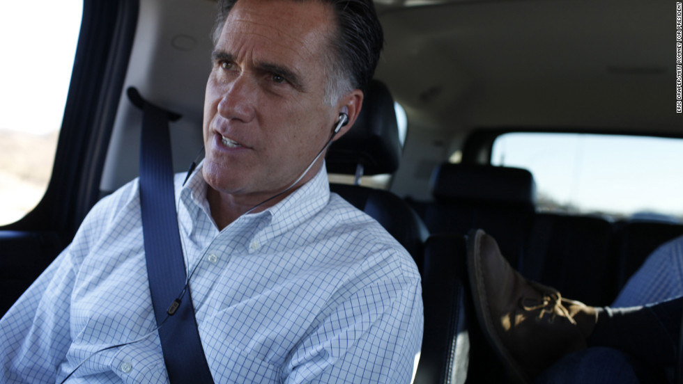 Romney is briefed on Hurricane Sandy during phone call inside his vehicle in Des Moines, Iowa, Oct. 29, 2012.