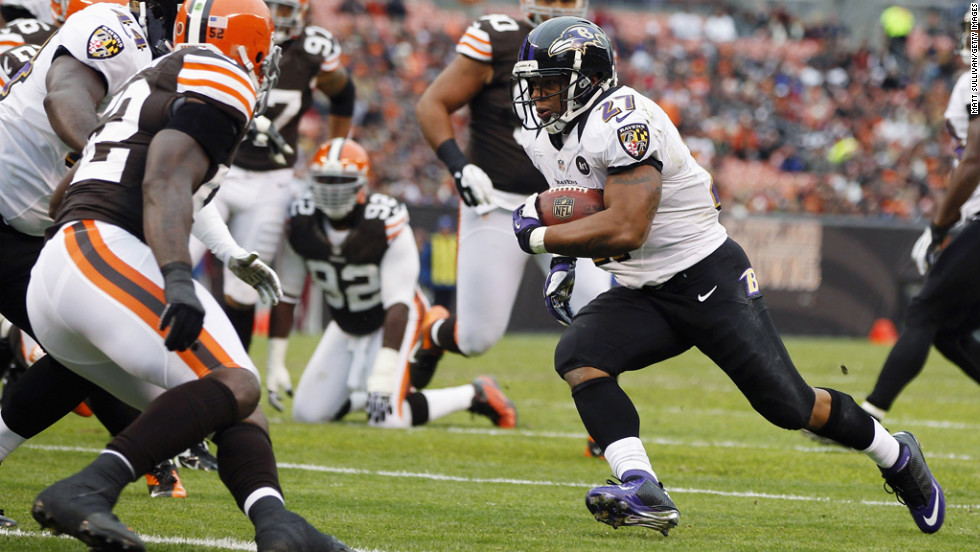 Running back Ray Rice of the Baltimore Ravens scores a touchdown in front of defensive back Buster Skrine of the Cleveland Browns at Cleveland Browns Stadium on Sunday in Ohio.