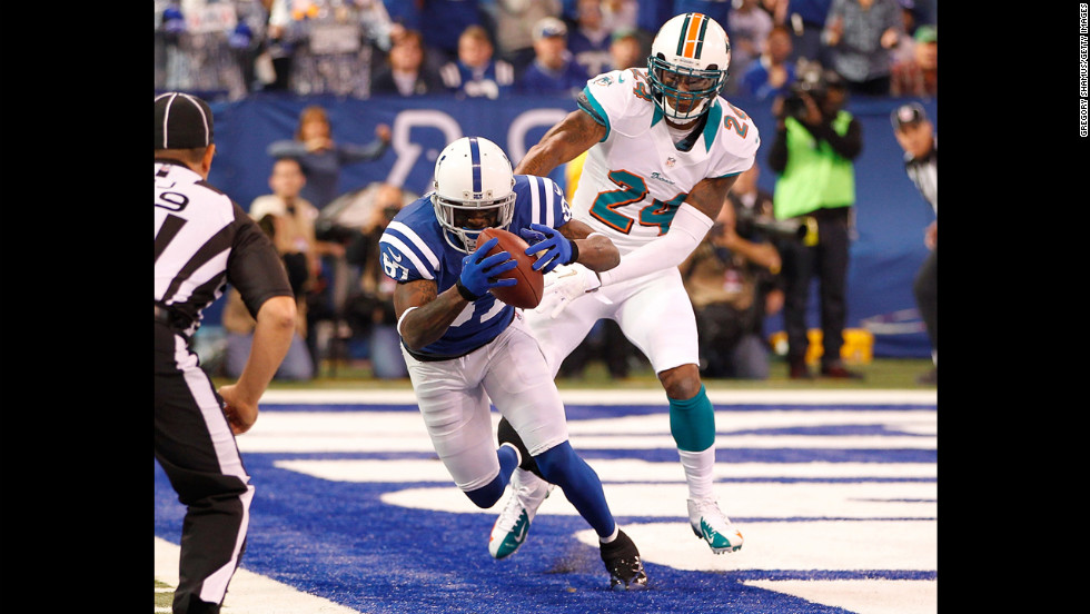 Reggie Wayne of the Colts catches a first quarter touchdown in front of Sean Smith of the Dolphins on Sunday.