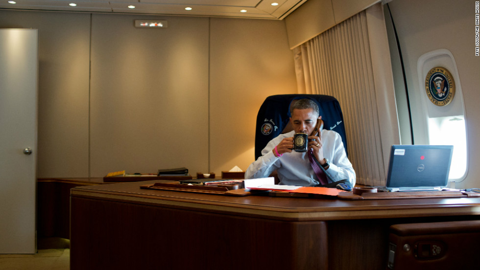 President Barack Obama convenes a conference call to discuss the response to Hurricane Sandy in his office aboard Air Force One during the flight to New Hamsphire on Oct. 27, 2012.