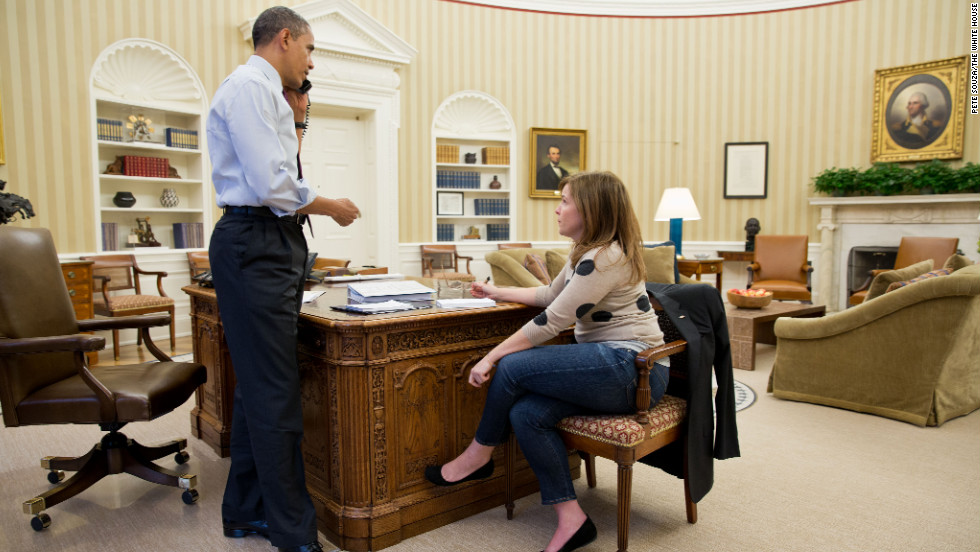 Obama discusses the response to Hurricane Sandy by phone with New Jersey Gov. Chris Christie, while Alyssa Mastromonaco, the Deputy White House Chief of Staff for Operations, sits at right in the Oval Office on Oct. 30, 2012.
