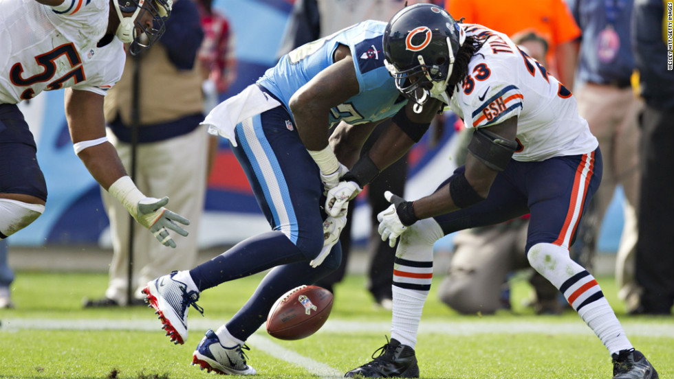 Chris Johnson of the Titans fumbles the ball after being hit by Charles Tillman of the Bears on Sunday.
