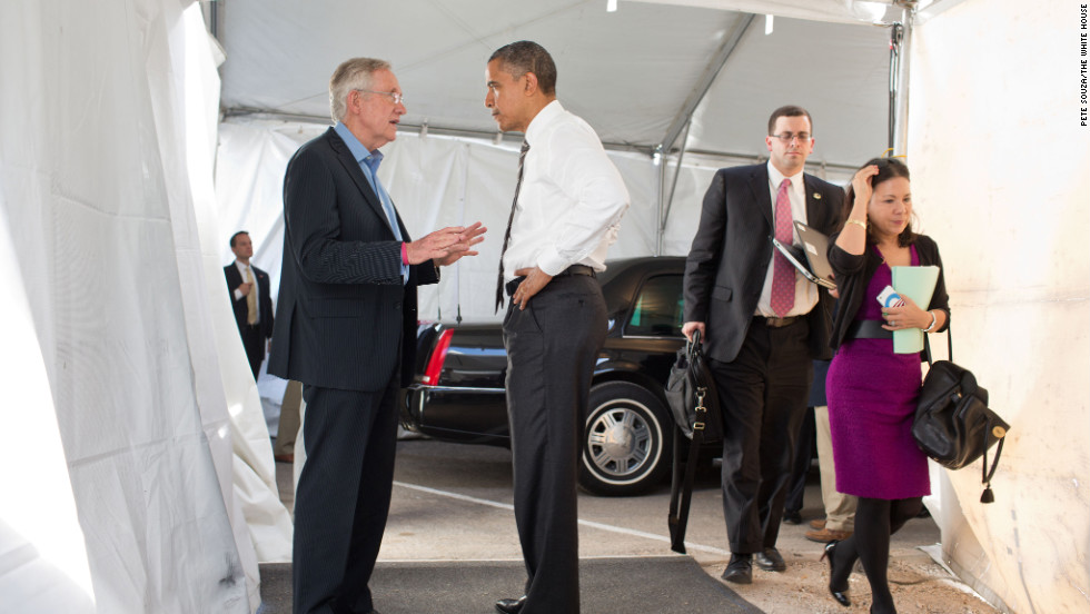 Obama greets Senate Majority Leader Harry Reid, D-Nevada, at the Cheyenne Sports Complex in Las Vegas on Nov. 1, 2012.