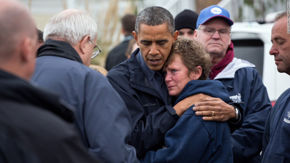 Obama hugs Donna Vanzant, the owner of North Point Marina, as he tours damage from Hurricane Sandy in Brigantine, New Jersey, on Oct. 31, 2012.